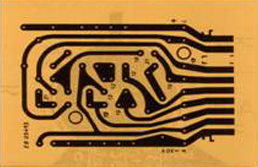 Image of a printed circuit board with etched copper lines on one side